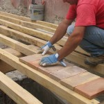 laying terracotta pianelle on timber